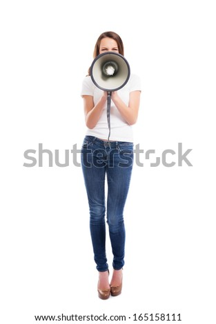 A young and attractive Caucasian woman in stylish jeans screaming on the megaphone isolated on white background - stock photo