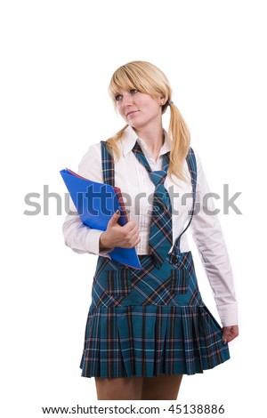 A young and beautiful schoolgirl  is wearing a traditional uniform is holding folders on white background. Senior high school student in uniform with documents. - stock photo