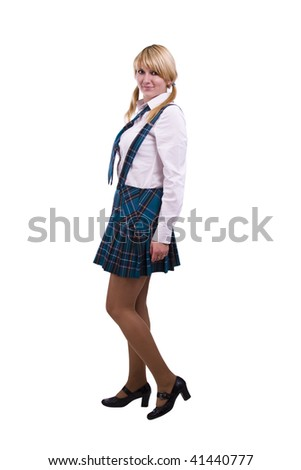 A young and beautiful schoolgirl  is wearing a traditional uniform is smiling on white background. Senior high school student in uniform is posing - stock photo