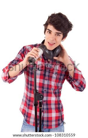 A young and handsome boy singing - stock photo