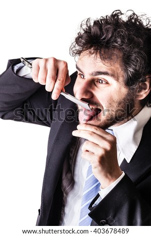 a young and handsome businessman holding a cut-throat razor isolated over a white background