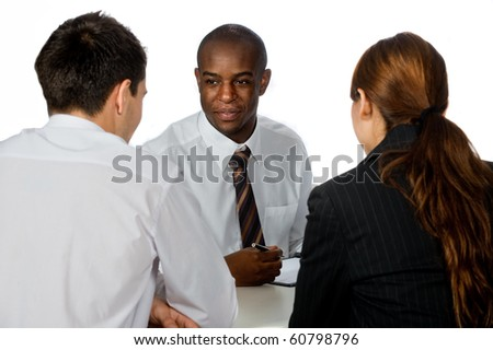 A young and professional businessman having a discussion with two of his colleagues on white background - stock photo