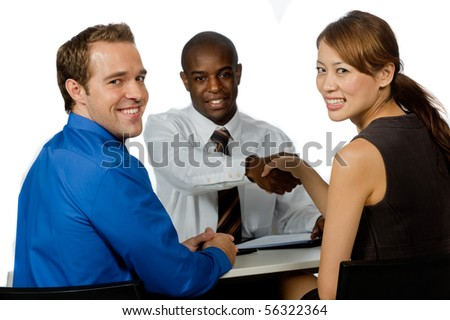 A young and professional businessman shaking hands and securing a deal in his office - stock photo