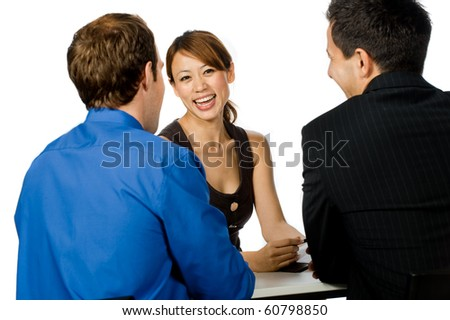 A young and professional businesswoman having a discussion with two of her colleagues on white background - stock photo