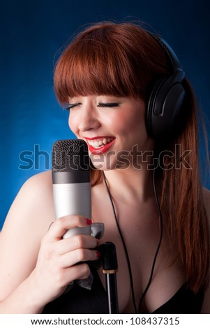 A young and very beautiful woman singing