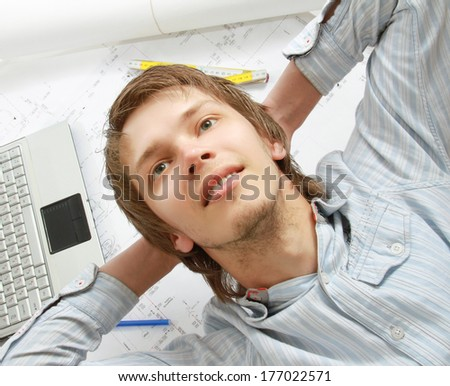 A young architect at his workplace - stock photo