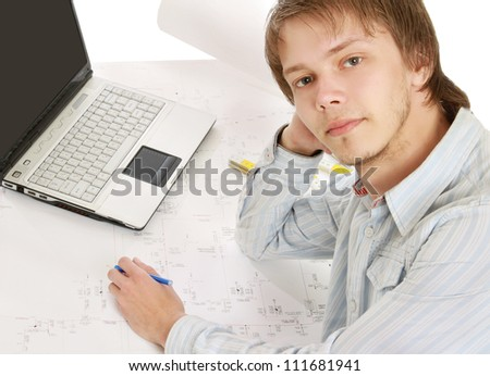 A young architect at his workplace, back-view - stock photo