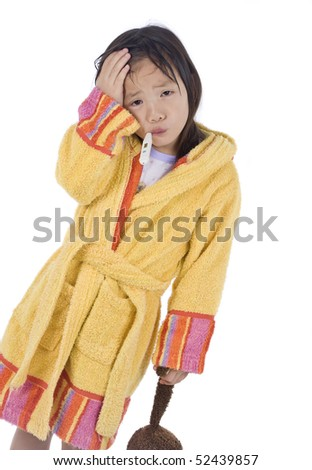 A young Asian child is sick and taking medicine - stock photo