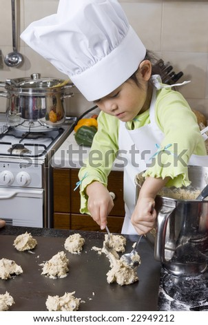A young asian girl cooking up something in the kitchen.