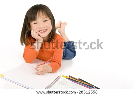 A young asian girl drawing a picture. On white - stock photo