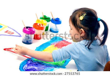 A young asian girl having fun painting a picture