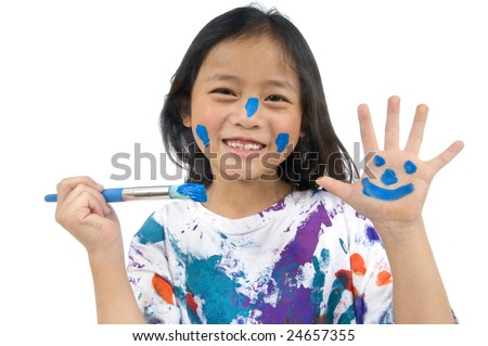 A young asian girl having fun painting her hands - stock photo