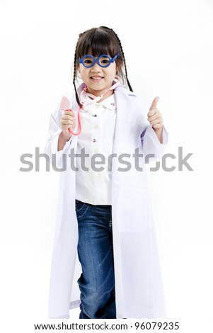 A young asian girl having fun playing dress up as a doctor