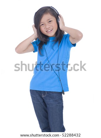 A young Asian girl listening to music - stock photo