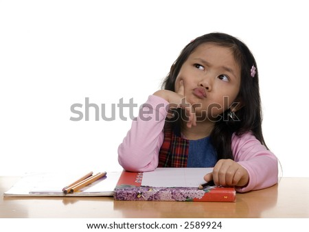A young Asian Girl thinks about what to write next - stock photo