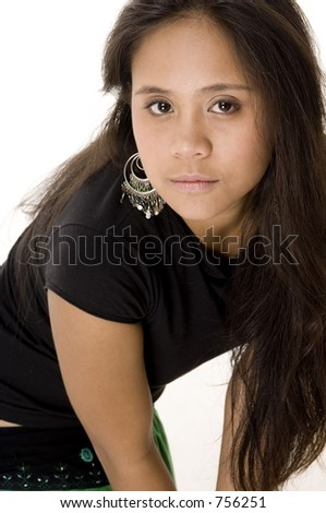 A young asian model in black poses in a studio with a white background
