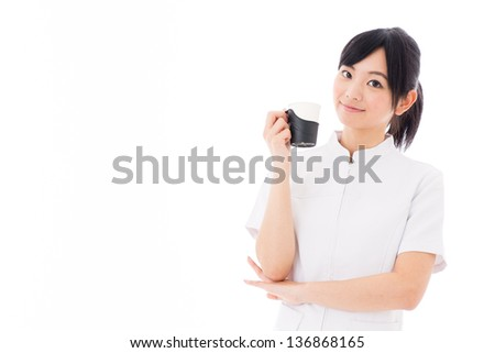 a young asian nurse relaxing on white background - stock photo