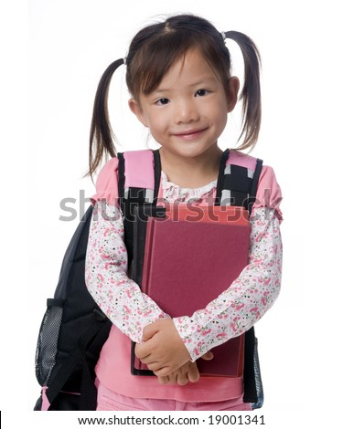 A young asian school girl ready for school. - stock photo