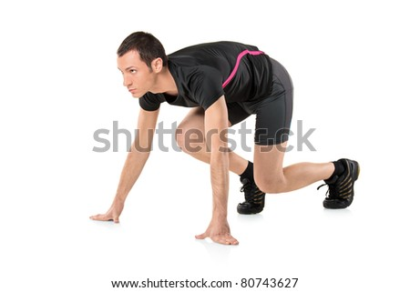 A young athlete ready to run isolated on white background - stock photo