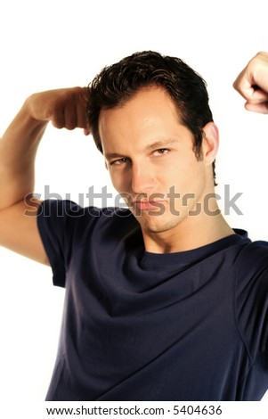 a young, attractive and strong business man is making a fist
