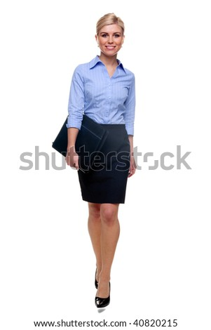 A young attractive blonde businesswoman carrying her document case walking towards, isolated on a white background.