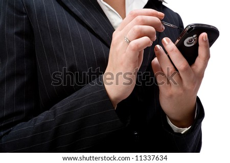 A young attractive businesswoman holding a handheld device on white background - stock photo