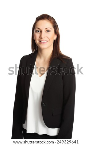 A young attractive businesswoman in her 20s, standing isolated on a white background wearing a black suit and white shirt. White background. - stock photo