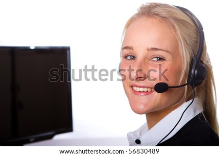 A young, attractive businesswoman wearing headphones
