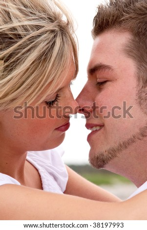 A young attractive couple kissing