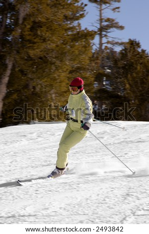 A young attractive girl is skiing at lake Tahoe resort, California. - stock photo