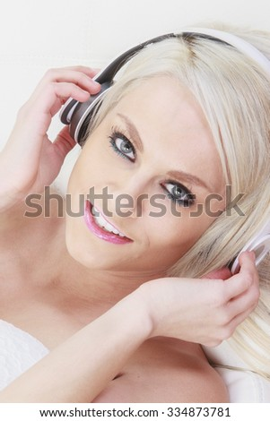A Young attractive girl listening to the music in modern interior