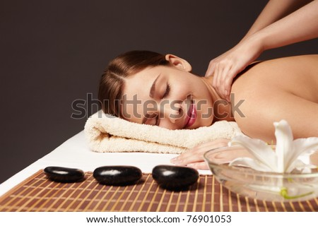 A young attractive girl make massage - stock photo