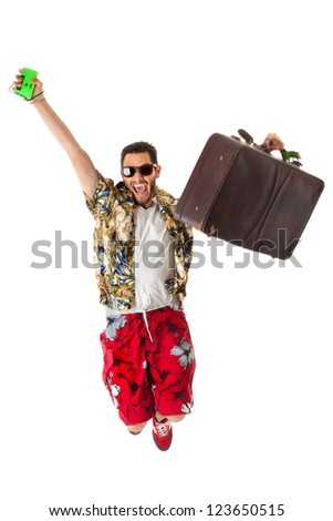 a young, attractive male in a colorful outfit ready to travel as a stereotype tourist