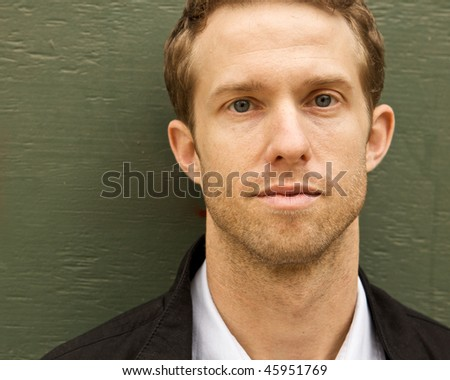 A Young Attractive Man with a serious look - stock photo