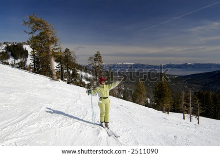 A young attractive woman enjoys the winter at a ski resort at northern Lake Tahoe, California. - stock photo