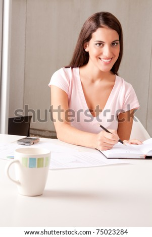 A young attractive woman in a business meeting - stock photo