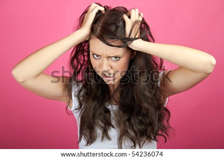 A young attractive woman is screaming - stock photo