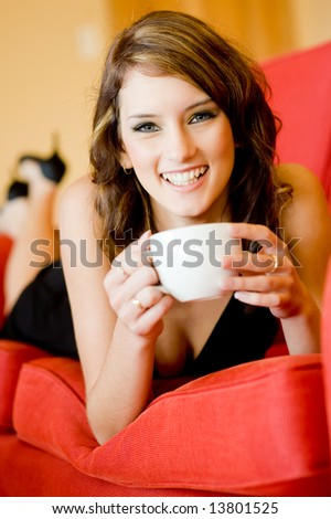 A young attractive woman relaxing on sofa at home