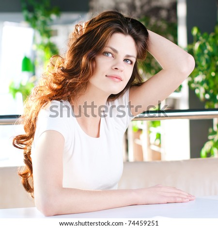 A young attractive woman sitting in a cafe