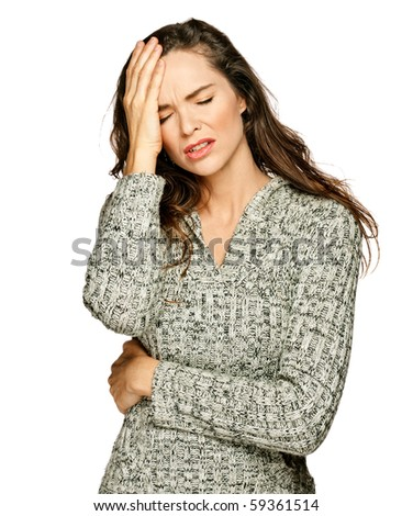 A young attractive woman suffering from illness or headache holding her head. Isolated on white.