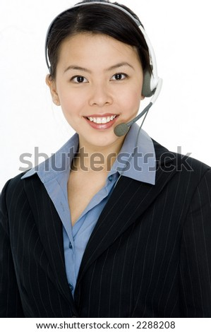 A young attractive woman wearing a headset on white background