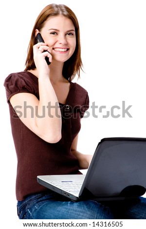 A young attractive woman with laptop and mobile phone on white background - stock photo