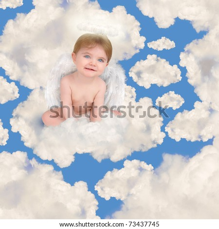 A young baby is sitting in a sky of clouds with feather wings and a halo. The child is happy and smiling. - stock photo