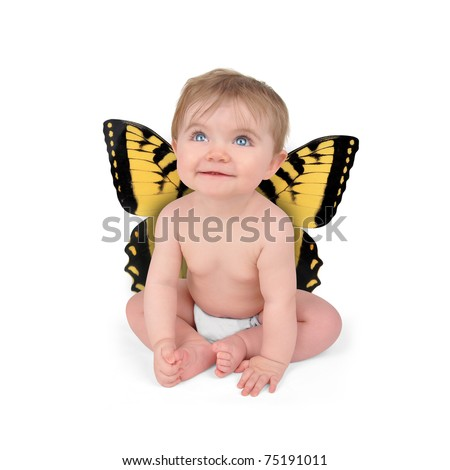 A young baby is sitting on a white isolated background with yellow butterfly wings. The child is looking up.