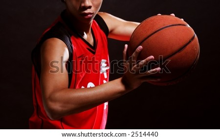 A young basketball player in red jersey - stock photo