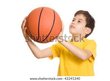 A young basketball player sets up for the shot- focus on the Basketball