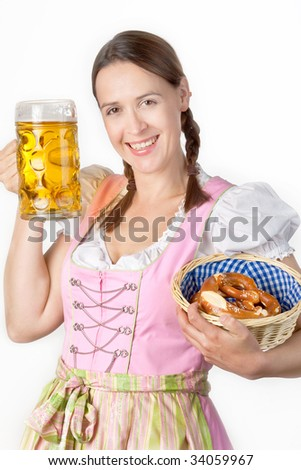 A young Bavarian girl in a Dirndl holding a beer and a basket of Brezn.