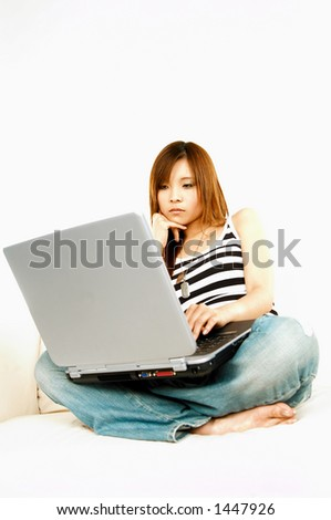 A young beautiful asian women working with her laptop computer