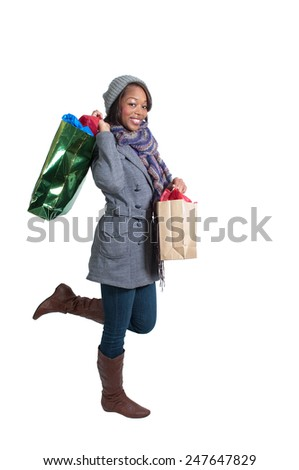 A young beautiful black African American woman on a shopping spree - stock photo