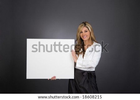 a young beautiful business woman holding a blank white sign - stock photo